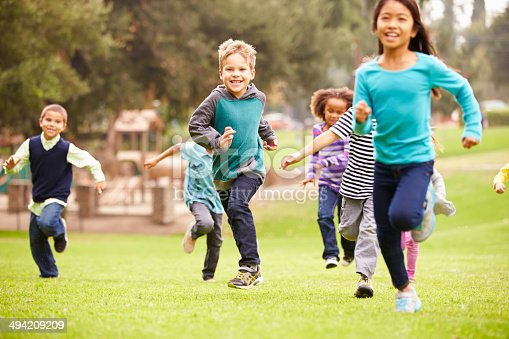 istock Group Of Young Children Running Towards Camera In Park 494209209