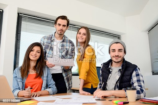 918746260istockphoto group of young cool hipster business people in casual wear working together in meeting room of a startup company 653116588