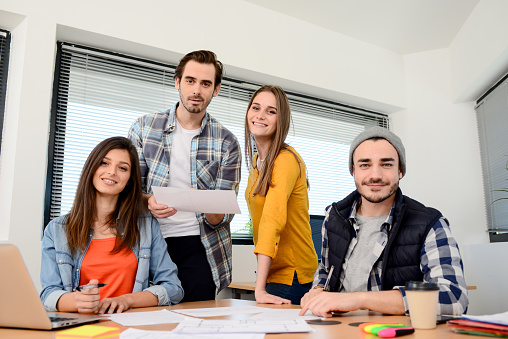 918746260 istock photo group of young cool hipster business people in casual wear working together in meeting room of a startup company 653116588