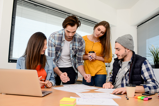 918746260 istock photo group of young cool hipster business people in casual wear working together in meeting room of a startup company 653116594