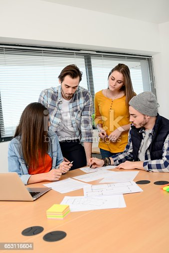 918746260istockphoto group of young cool hipster business people in casual wear working together in meeting room of a startup company 653116604