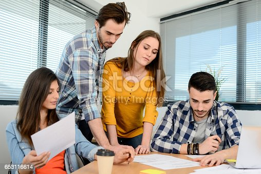 918746260istockphoto group of young cool hipster business people in casual wear working together in meeting room of a startup company 653116614