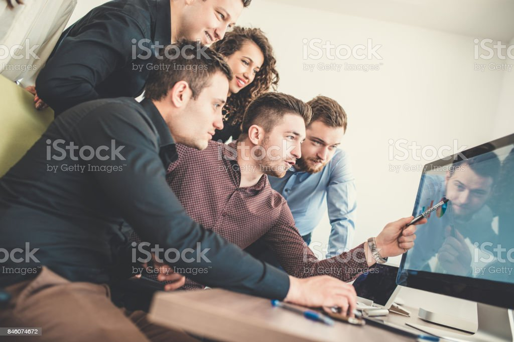 Group of Young Coworkers Working on Project in Modern Office stock photo