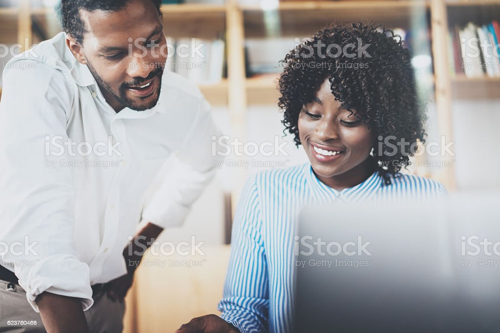 Group of young coworkers working together in a modern office stock photo