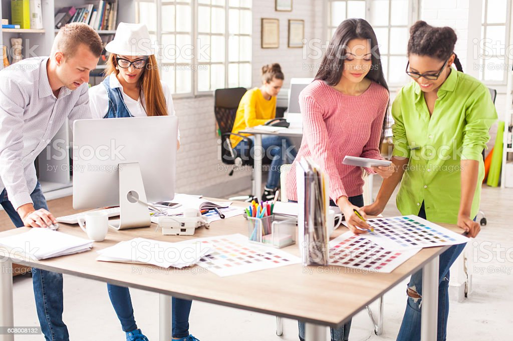 Group of young creative designers working at modern studio stock photo