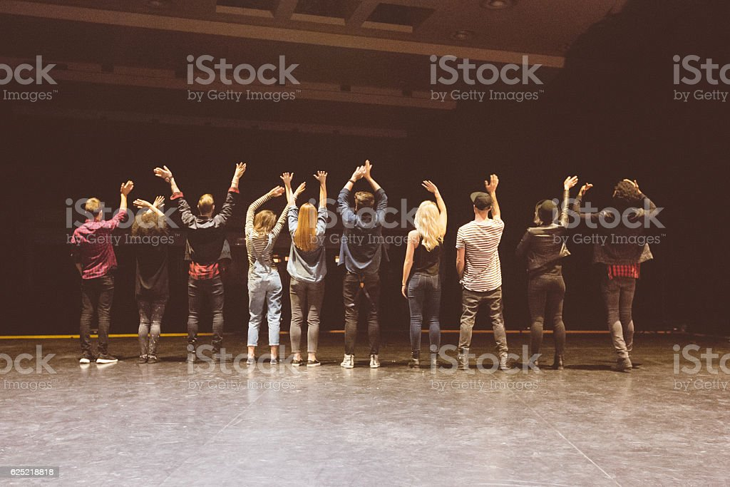 Group of young dancers on the stage stock photo