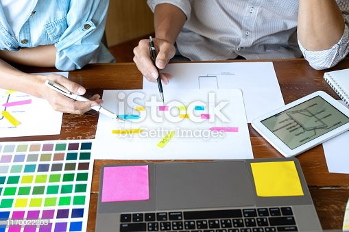 istock Group of young designer working in the office to design a new product, use color chart and computer laptop for new smartphone design concept 1170022203