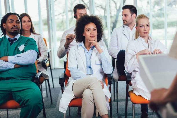 Group of young doctors on seminar in lecture hall at hospital stock photo