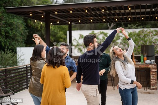 Group of young friends dancing together.