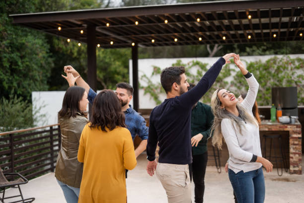 Group of young friends dancing stock photo