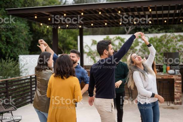 Group Of Young Friends Dancing Stock Photo - Download Image Now