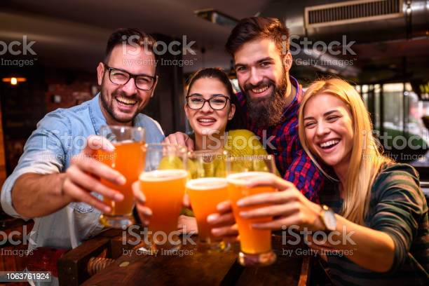 Group of young friends in bar drinking beer toasting the camera picture id1063761924?b=1&k=6&m=1063761924&s=612x612&h=ofcnt4uwau2xaksqxwubva9ll2hnu3rttlpkooa 5ei=