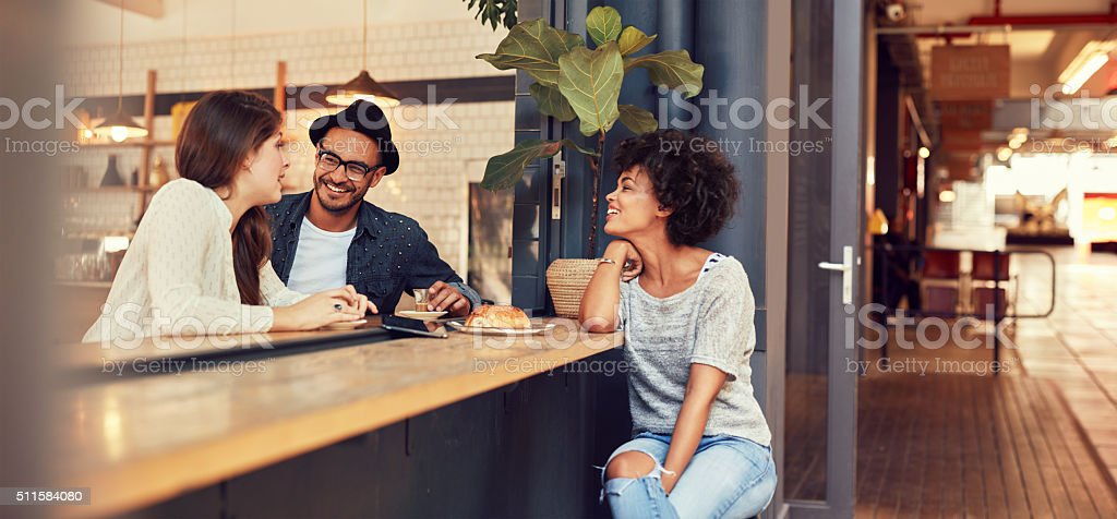 Group of young friends meeting in a cafe stock photo