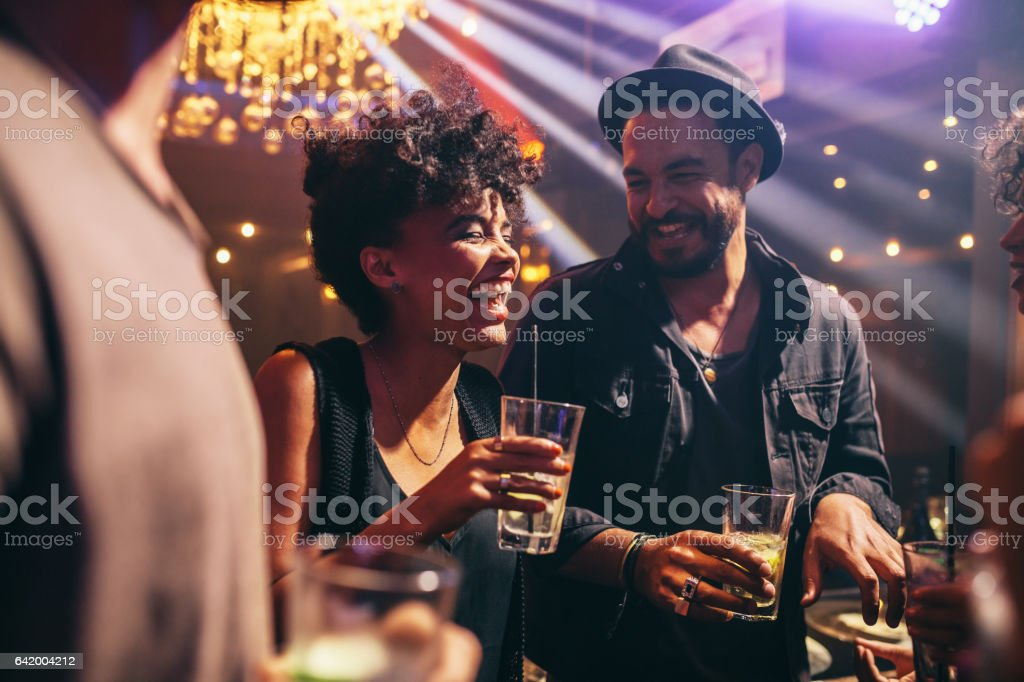 Group of young friends on a night out stock photo