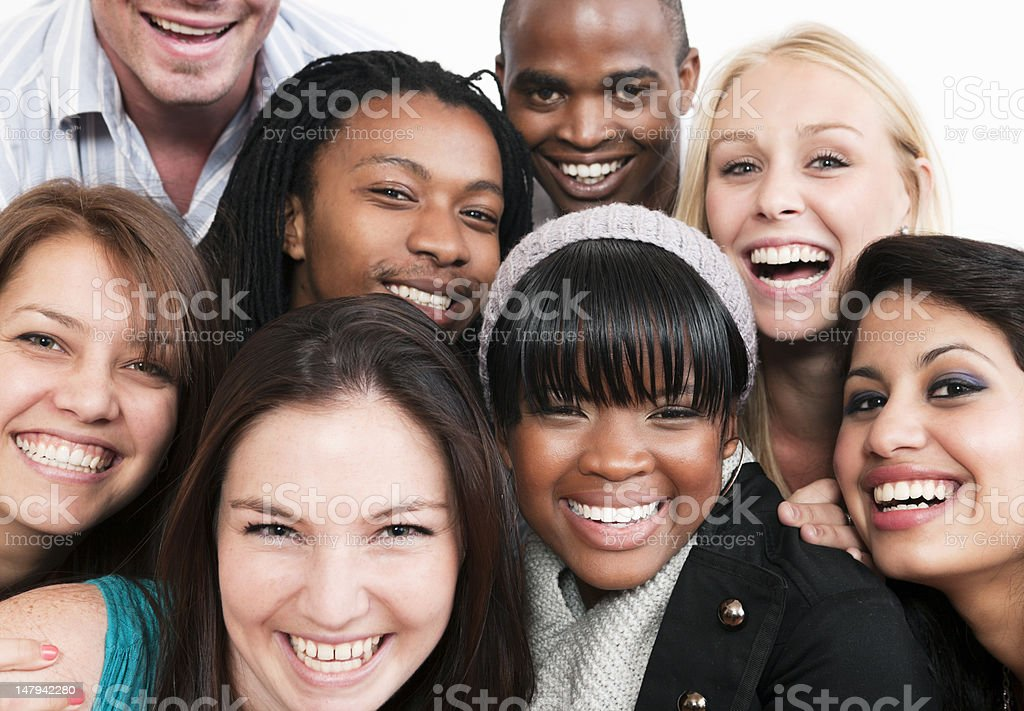 Group of young friends or colleagues smile together royalty-free stock photo