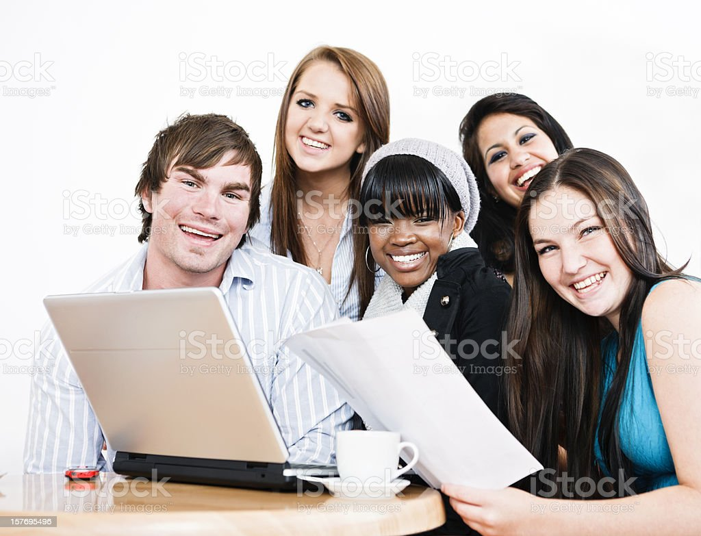 Group of young friends smile round laptop in coffee shop royalty-free stock photo