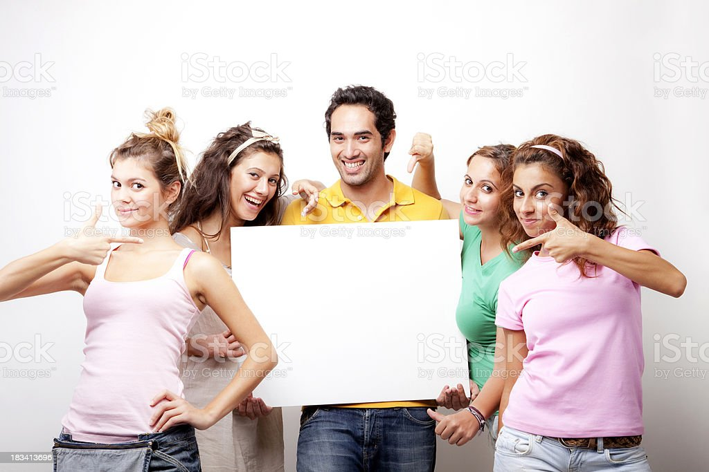 Group of young friends with a banner ad royalty-free stock photo