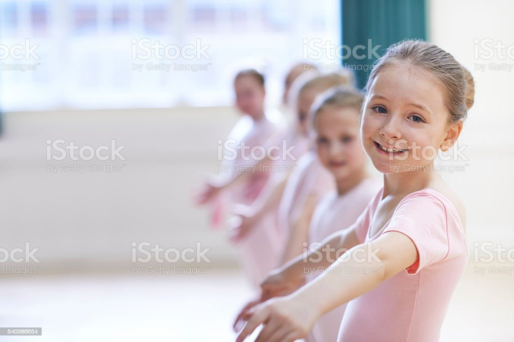 Group Of Young Girls In Ballet Dancing Class stock photo