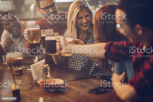 Group of young joyful friends having fun while toasting with beer in picture id955942630?b=1&k=6&m=955942630&s=612x612&h=ee5lwj4bmso8uczmqgvv4tt zpvbiik cwdqsgn3dec=