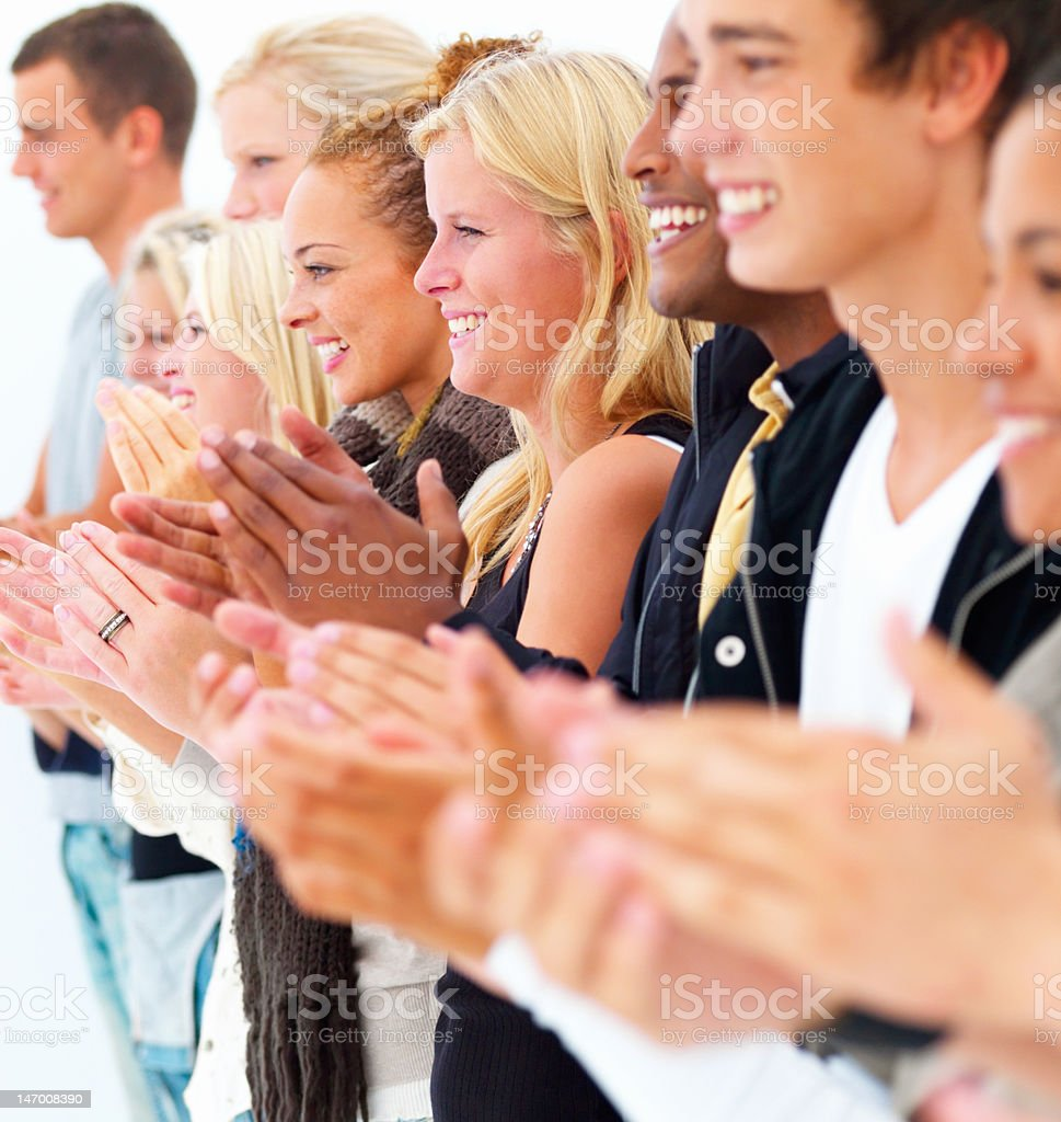 Group of young men and women clapping royalty-free stock photo