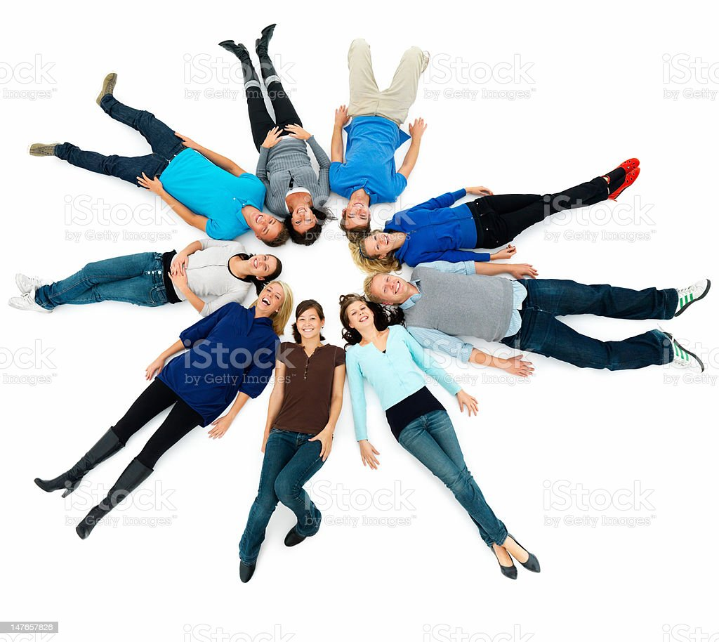 Group of young men and women lying on floor royalty-free stock photo