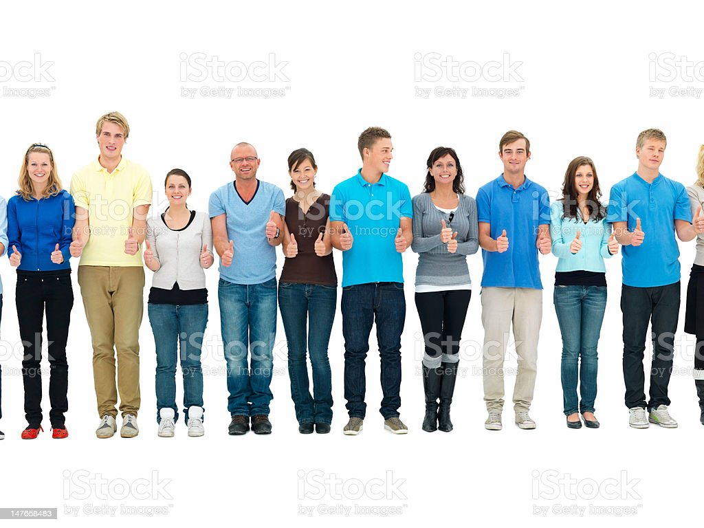 Group of young men and women showing thumbs up royalty-free stock photo