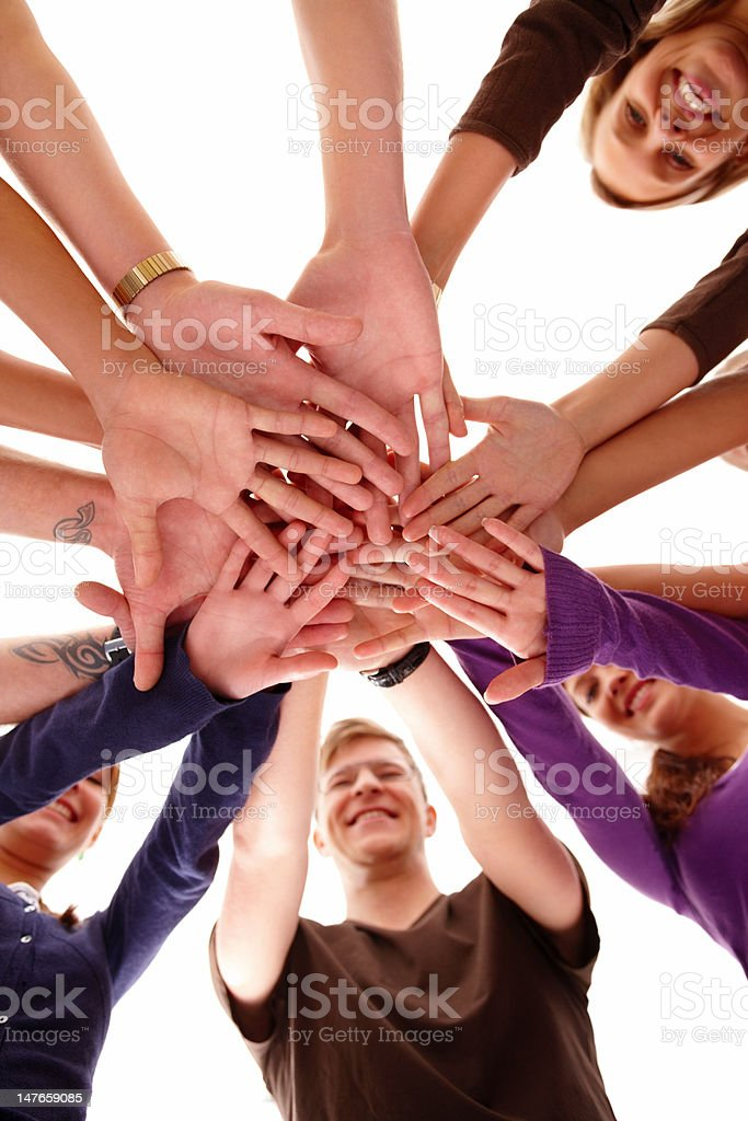 Group of young men and women showing unity royalty-free stock photo