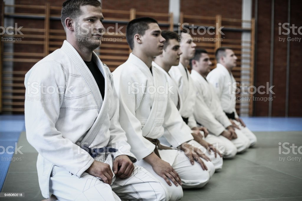Group of young men at sports class. stock photo