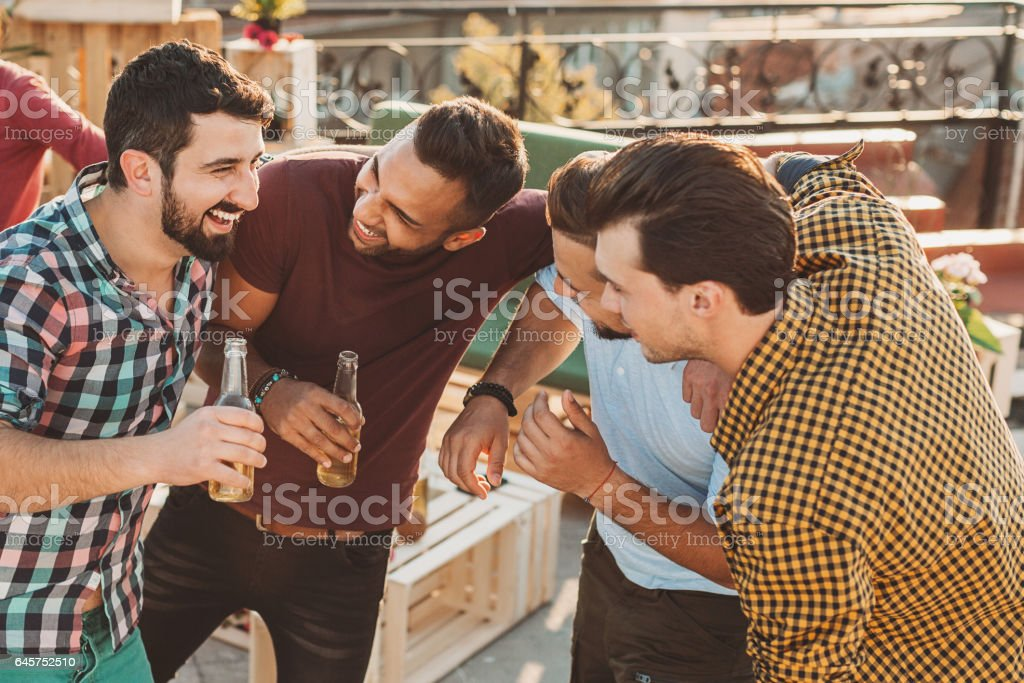 Group of young men on a party stock photo