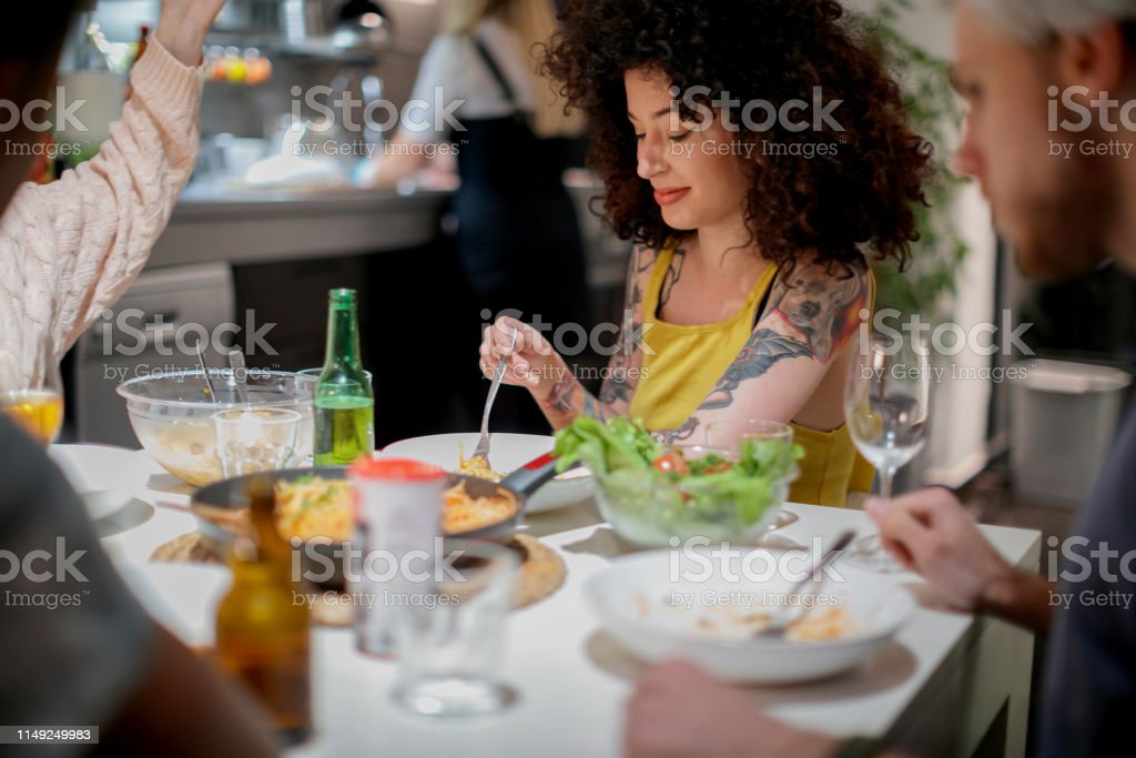 Group of millennials roomates dining at home