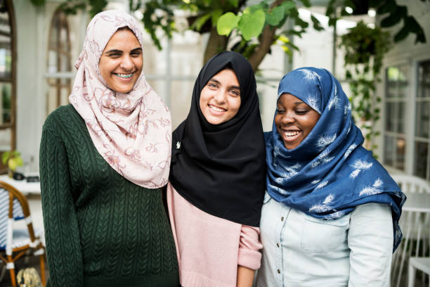 a group of young muslim women - arabic girl stock photos and pictures