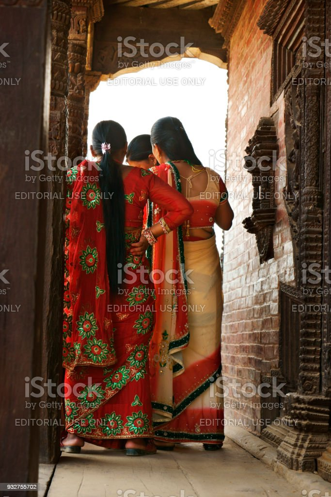 group of young nepalese women in traditional clothing talking stock photo