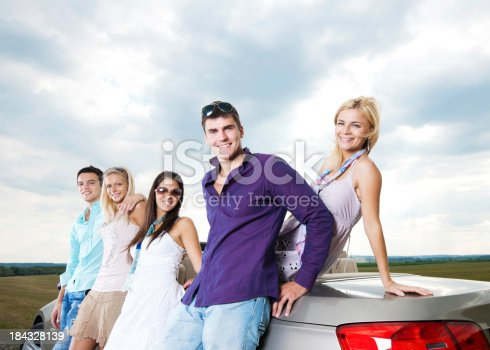 481388538 istock photo Group of young people and a cabriolet car. 184328139