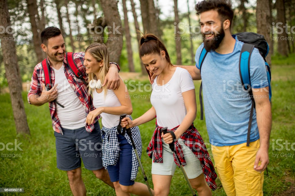 Group of young people are hiking in mountain royalty-free stock photo