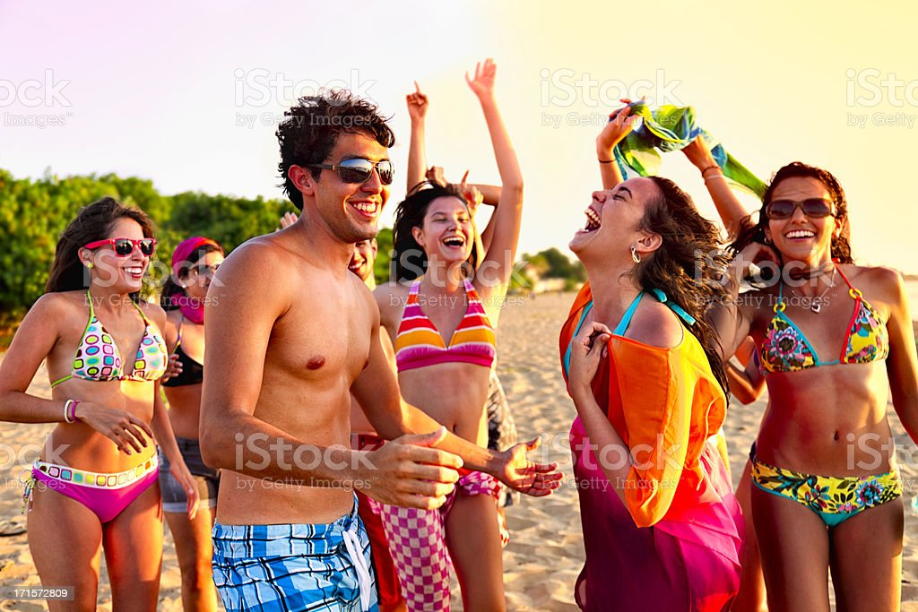 Group of young people at a spring break beach party stock photo