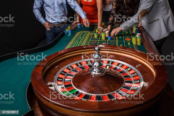 Group of young people behind roulette table picture id672626812?b=1&k=6&m=672626812&s=612x612&h=mum wfjieq jbgid5atxt9p41e9 gq70it3jjr2 5t4=