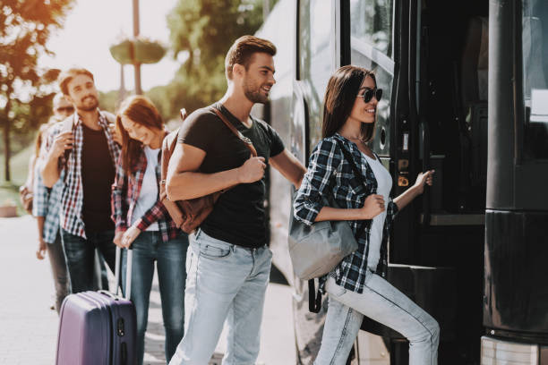 Group of Young People Boarding on Travel Bus stock photo