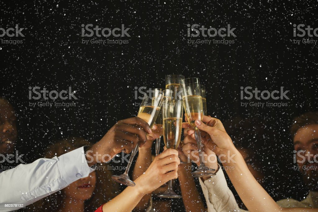 Group of young people celebrating new year with champagne at night club stock photo