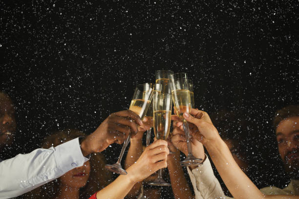 group of young people celebrating new year with champagne at night club - celebration stock pictures, royalty-free photos & images