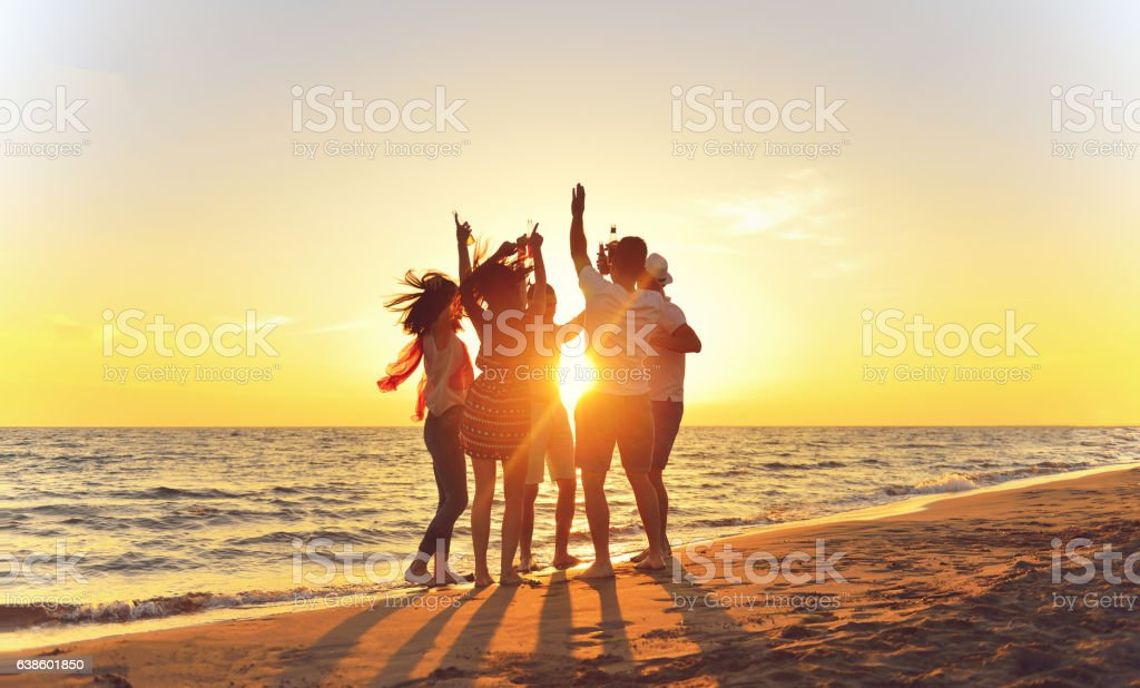 group of young people dancing at the beach - foto stock