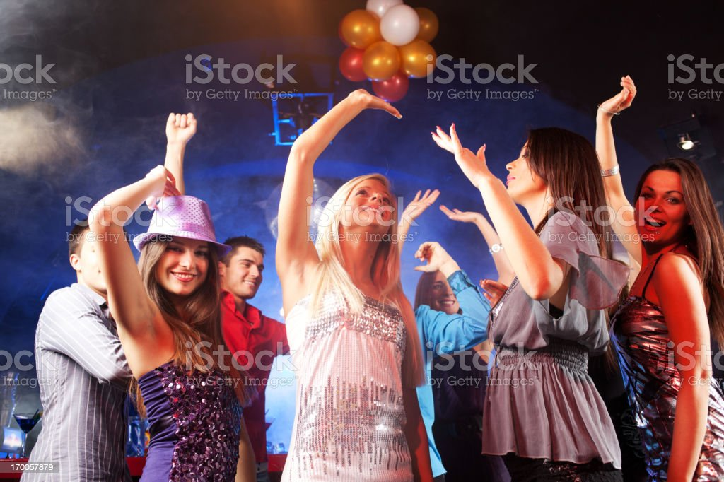 Group of young people dancing at the disco club. royalty-free stock photo