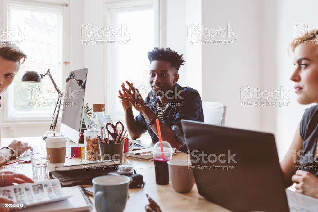 Group of young people discussing working stock photo