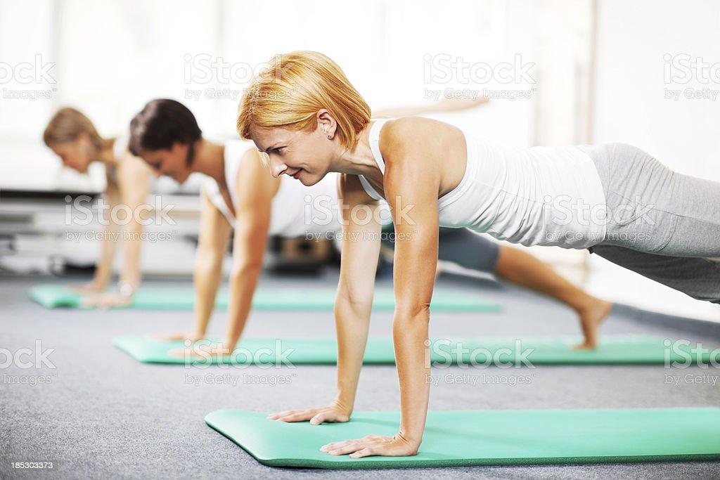 Group of young people doing Pilates exercises. stock photo