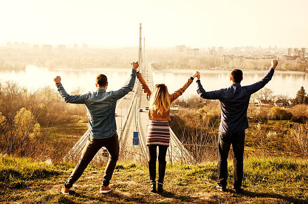 Group of young people enjoy sunny day near Danube river stock photo