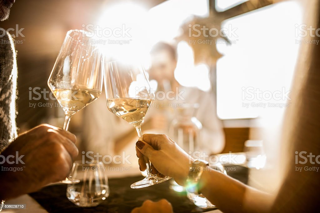 Group of Young People Enjoying Dinner at the Restaurant stock photo