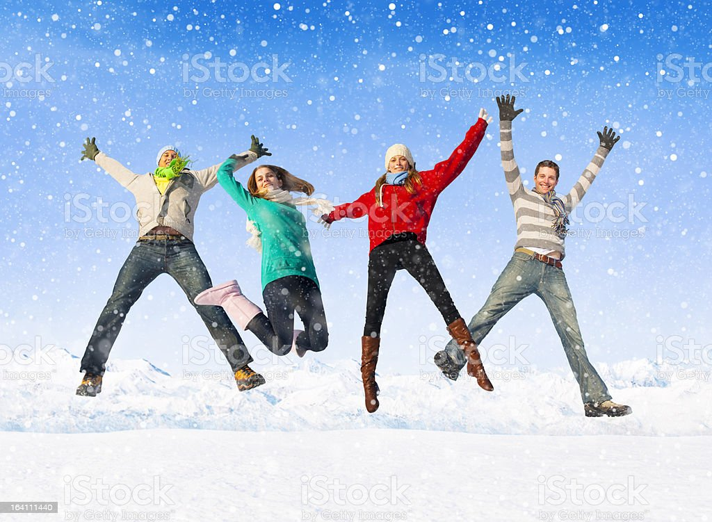 Group of Young People enjoying Winter royalty-free stock photo