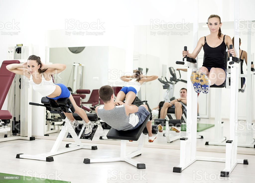 Group of young people exercise in the gym royalty-free stock photo