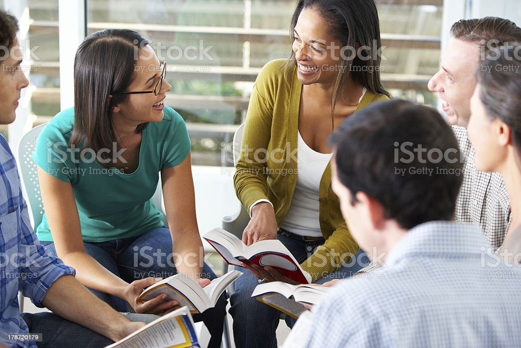 Group of young people gather for a bible study stock photo