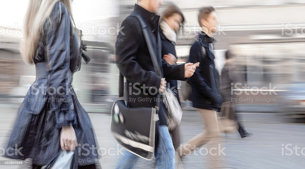 group of young people going along the street stock photo