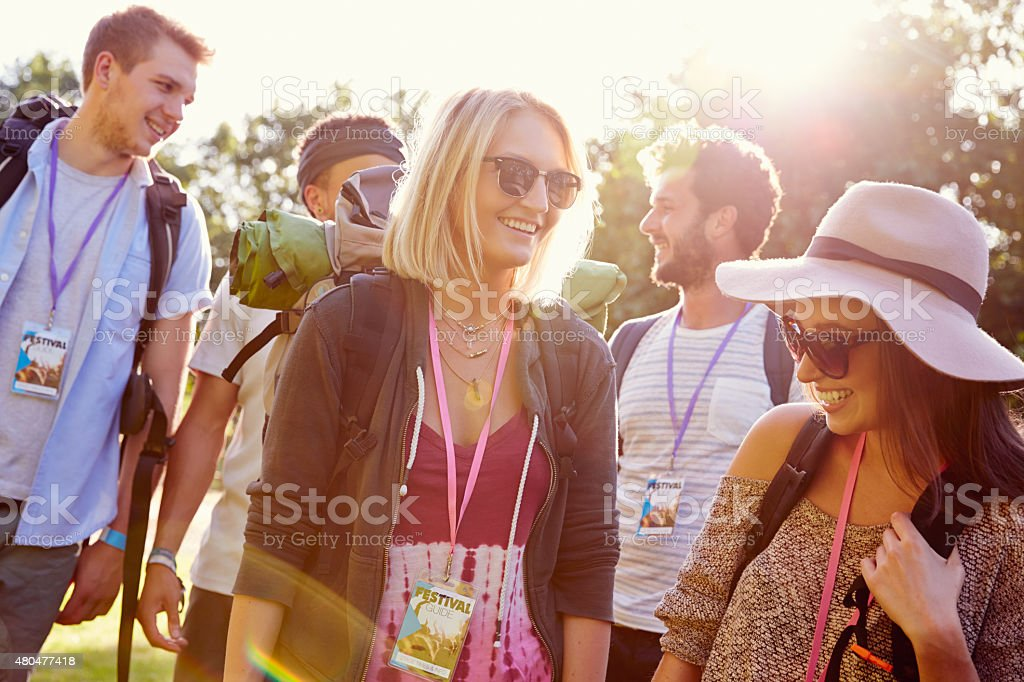 Group Of Young People Going Camping At Music Festival stock photo